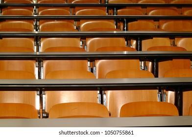 empty desks in the university classroom