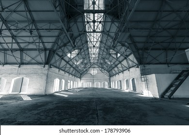 an empty desolate industrial building inside, attic