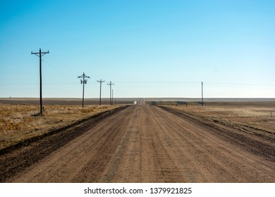 Empty Desolate Rural Dirt Road on a Sunny Day