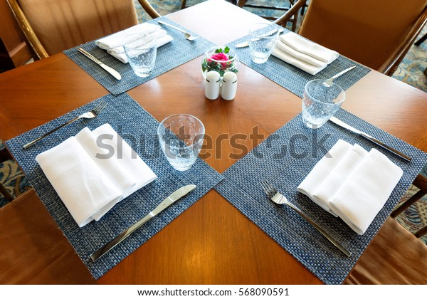 Empty dining table and chairs set in restaurant