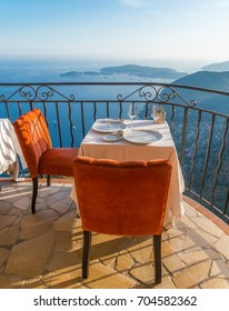 Empty dining table with stunning views overlooking the French Riveira on a sunny day