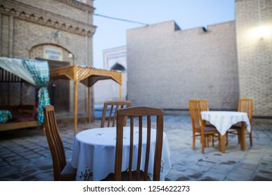 Empty dinner tables on a quiet street