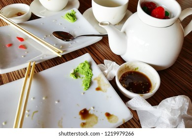 Empty dirty plate of sushi on table in cafe