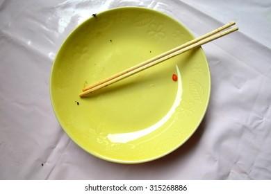 Empty dish and chopsticks