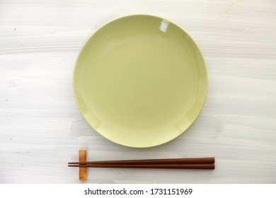 empty dish with chopsticks on a table