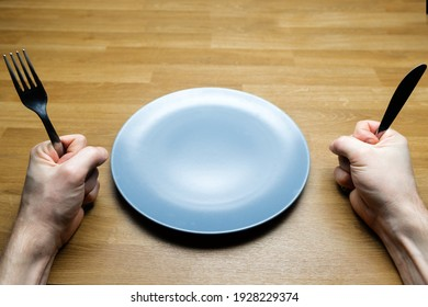 Empty dish on table with man demanding food