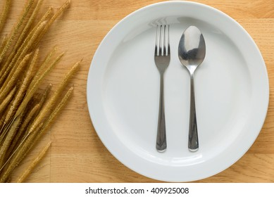 Empty Dish with Spoon and Fork Background