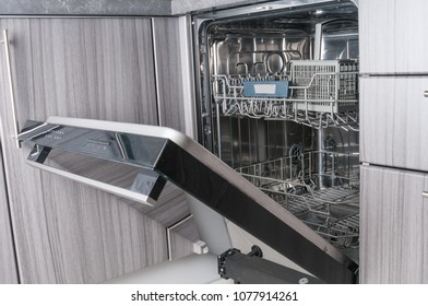 Empty dishwasher machine with opened door