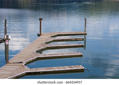 Empty docks on Lake Coeur d'Alene on a sunny spring afternoon