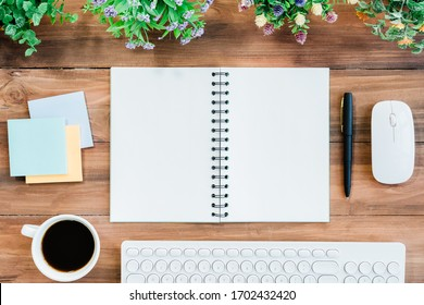 Empty double opened page of diary with coffee cup and accessories on wood table. Business background concept. - Shutterstock ID 1702432420