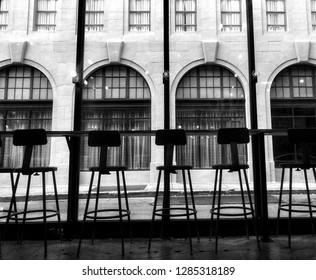 Empty Downtown Metal Bar Stools Windows Arched Glass Brick Facade in Atlanta Georgia