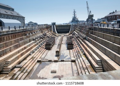 An empty dry dock rests after decades of holding enormous ships as they were built.