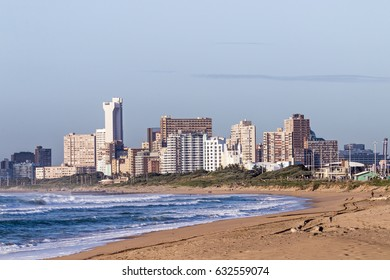 Empty early morning beach against Durban city skyline in South Africa