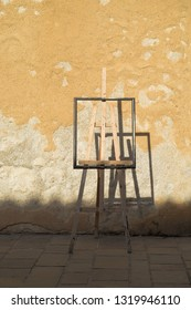 empty easel against a sunny wall