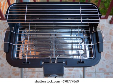 An empty electric grill stove for your barbecue or stake, ready to cook meat
