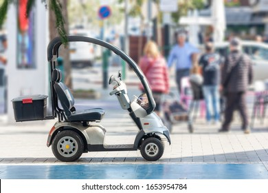 Empty electric scooter parked on the street
