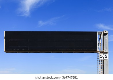 Empty electronic highway sign with blue sky in the background