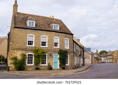 Empty English residential street with row of restored traditional British Victorian houses