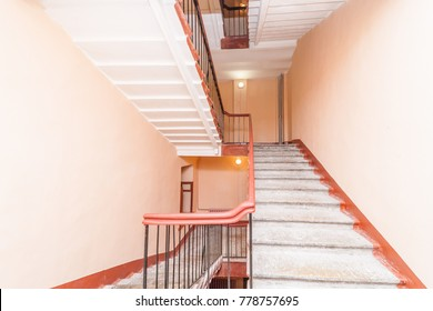 empty entrance in apartment building stairwell beige color