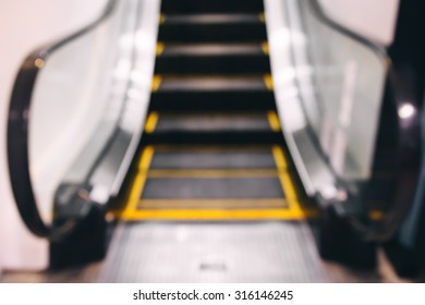 Empty escalator going up with motion blur.