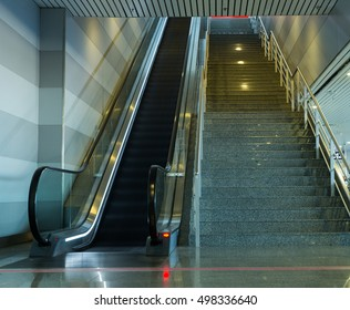 Empty escalator and stairs at the airport or shopping mall