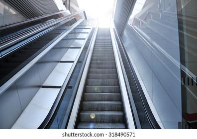 Empty escalator stairs - light effect