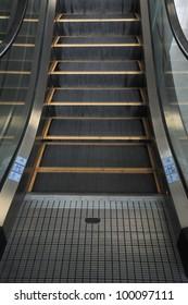 Empty escalator stairs logo warning
