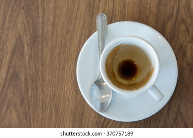 empty espresso cup on wood surface