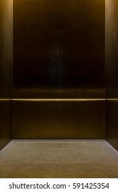 Empty Fancy Elevator Carriage Metal Pole Inside Metal Box Interior Closed Elegant Gold Bronze Overhead Floor Trap Blank Room