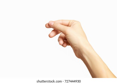 Empty female hand making gesture like holding something isolated at white background.