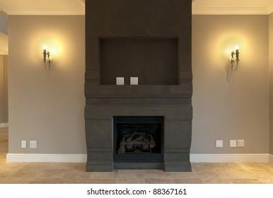 Empty fireplace and lounge inside a modern house