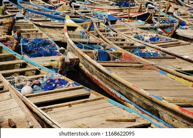 Empty fisher boats with nets after fishing in the african port of Lome
