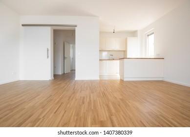 empty flat with wooden beech flooring - Shutterstock ID 1407380339
