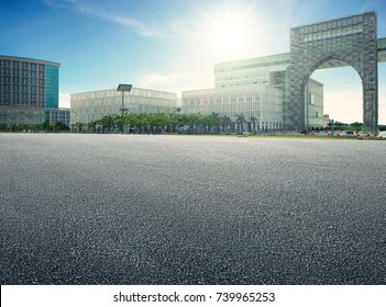 Empty floor with backdrop on modern buildings at sunrise time