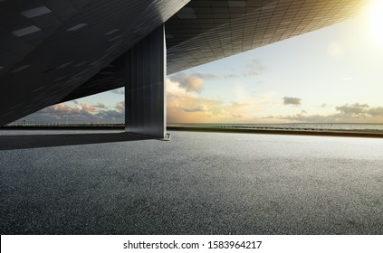 Empty floor ground and modern building rooftop with beautiful evening sky.