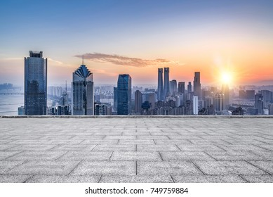 Empty floor with modern skyline and buildings