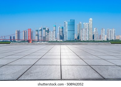 Empty floor with modern skyline and buildings,cityscape and skyline of chongqing from empty brick floor