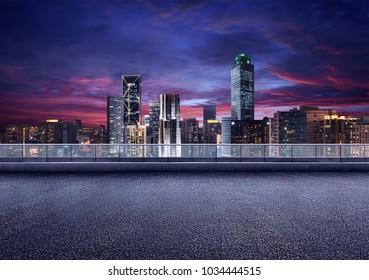 Empty floor platform with night view city skyline background