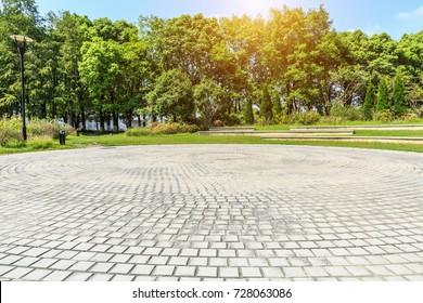 empty floor road and green plant in quiet city park