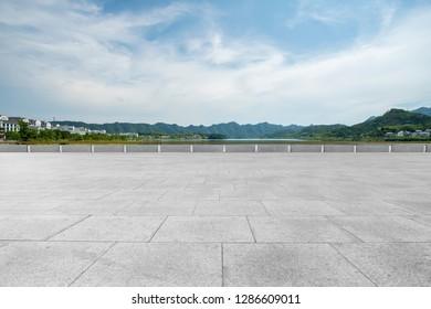 Empty floor tiles and outdoor natural landscape - Shutterstock ID 1286609011