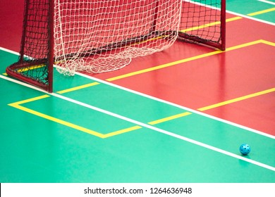 Empty Floorball goal with the ball in the net