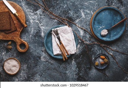 Empty food table Simple modern kitchen still life in black ceramic plate bowls against a black blue marble wall marble