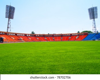 empty football field cup with lamps and green grass