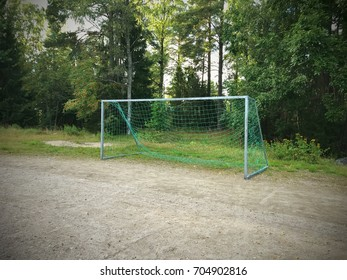Empty football or soccer goal or net in forest.