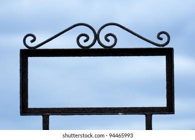 Empty frame against blue sky