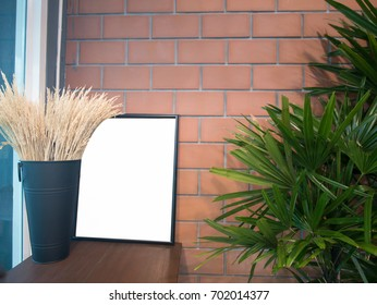 Empty frame in the brick style cafe background for advertising poster