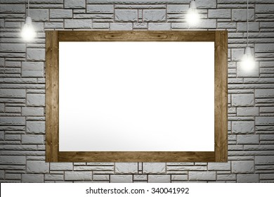 Empty frame of painting hanging on the brick wall