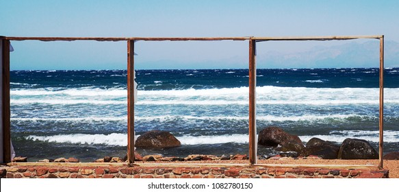 Empty frames on beach. Picture of sea. Triptich Sea. Red Sea, Dahab, Sinai, Egypt.