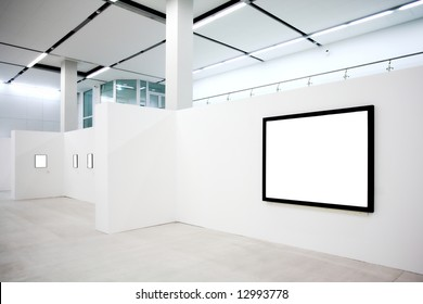 empty frames on white wall in museum
