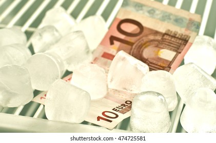 Empty fridge with ice and 10 euro bill in it.